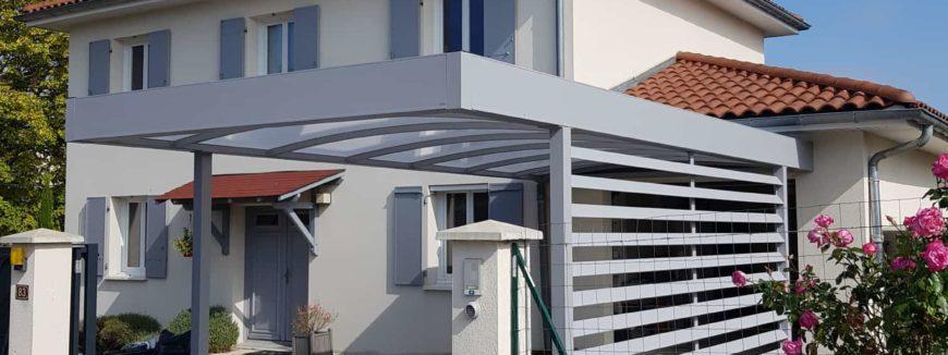 Carport à toit plat adossé à Brignais