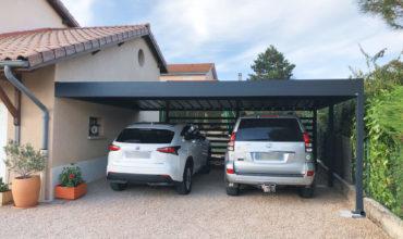 Carport en alu double sur mesure à toit plat réalisé à Dommartin.